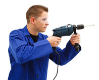 Young man with drill Stock Photos