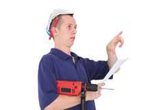 Young man with drill and paper hat Royalty Free Stock Photo