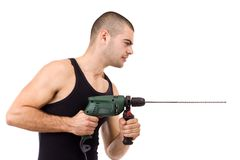 Young man drilling Royalty Free Stock Photography