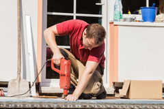 A young man drilling a hole Royalty Free Stock Photo