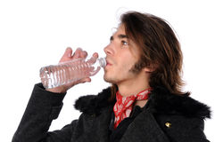Young Man Dringing Bottled Water Royalty Free Stock Image