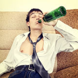 Young Man drink a Beer Stock Image