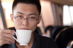 Young man drink coffee Royalty Free Stock Photo