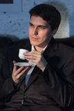 Young man  drink coffee Stock Photography