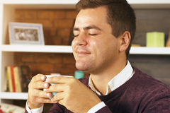 Young man drink coffee, tea or chocolate Stock Image