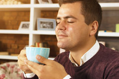 Young man drink coffee, tea or chocolate Royalty Free Stock Photography