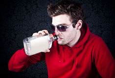 Young man drinking Royalty Free Stock Photo