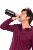 Young man drinking alcohol. Isolated on white Stock Photography