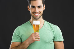 Young man drinking beer Stock Image