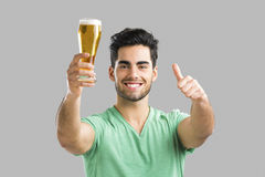 Young man drinking beer Royalty Free Stock Photography