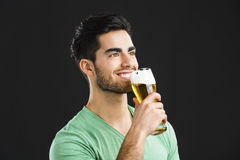 Young man drinking beer Stock Photography