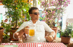 Young man drinking beer at restaurant Royalty Free Stock Image