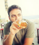 Young man drinking beer Royalty Free Stock Images