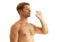Young man drinking bottled water Stock Photo