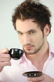 Young man drinking coffee Royalty Free Stock Photography