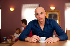Young man drinking coffee Royalty Free Stock Images