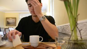 Young Man Drinking Coffee While Looking at Phone stock video footage