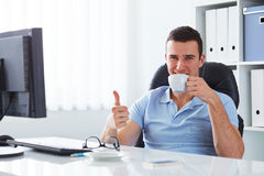 Young man drinking coffee Stock Image
