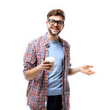 Young man drinking coffee portrait. Smiling happy male university student with drinking disposable coffee Royalty Free Stock Photography