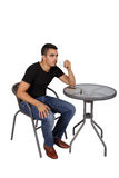Young man drinking coffee at a table Stock Photo