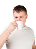 Young man drinking a cup Royalty Free Stock Photography