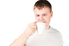 Young man drinking a cup Stock Photography