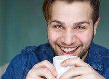 Young man drinking cup of coffee Royalty Free Stock Photography