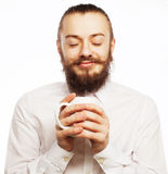 Young man drinking a cup of coffee Royalty Free Stock Image
