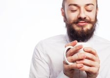 Young man drinking a cup of coffee Stock Photos