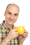 Young man drinking a cup of tea Royalty Free Stock Photos