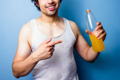 Young man drinking energy drink after a sweaty workout Stock Images