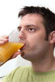 Young man Drinking fruit juice Stock Images