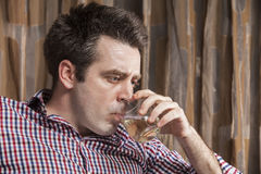 Young man drinking a glass of wine Royalty Free Stock Photo