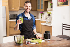 Young man drinking a healthy smoothie Stock Images