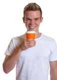 Young man drinking hot coffee Stock Images