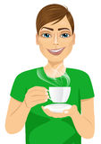 Young man drinking hot coffee or tea. Portrait of friendly handsome young man drinking hot coffee or tea  on white background Royalty Free Stock Image