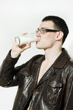 Young man drinking milk Royalty Free Stock Photos
