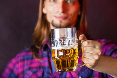 Young man drinking pint. Royalty Free Stock Photography