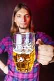 Young man drinking pint. Stock Photo