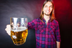 Young man drinking pint. Royalty Free Stock Image