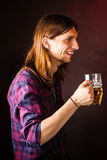 Young man drinking pint. Stock Images