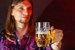 Young man drinking pint. Royalty Free Stock Photos
