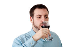 Young man drinking red wine Stock Photography