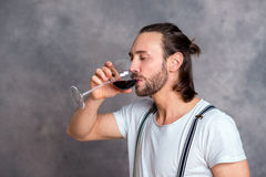 Young man drinking red wine Royalty Free Stock Image