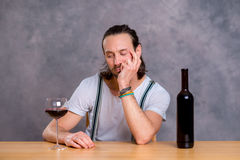 Young man drinking red wine Stock Images