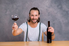 Young man drinking red wine Stock Image