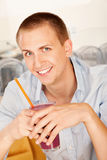 Young Man Drinking a Smoothie Royalty Free Stock Photography