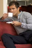 Young man drinking tea Stock Image
