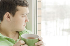 Young man drinking tea Royalty Free Stock Photography