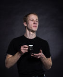 Young man drinking tea on a black Royalty Free Stock Photo